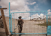 """Border Police. Over the Khargush (meaning """"Hare"""") Pass, near the Afghan border and the Wakhan corridor.<br /> <br /> Driving on the Pamir Highway (M41) from Khorog through the Pamir mountains.<br /> <br /> Tajikistan, a mountainous landlocked country in Central Asia. Afghanistan borders it to the south, Uzbekistan to the west, Kyrgyzstan to the north, and People's Republic of China to the east. Tajikistan also lies adjacent to Pakistan separated by the narrow Wakhan Corridor.<br /> Tajikistan became a republic of the Soviet Union in the 20th century, known as the Tajik Soviet Socialist Republic.<br /> It was the first of the Central Asian republic to gain independence in December 1991."""
