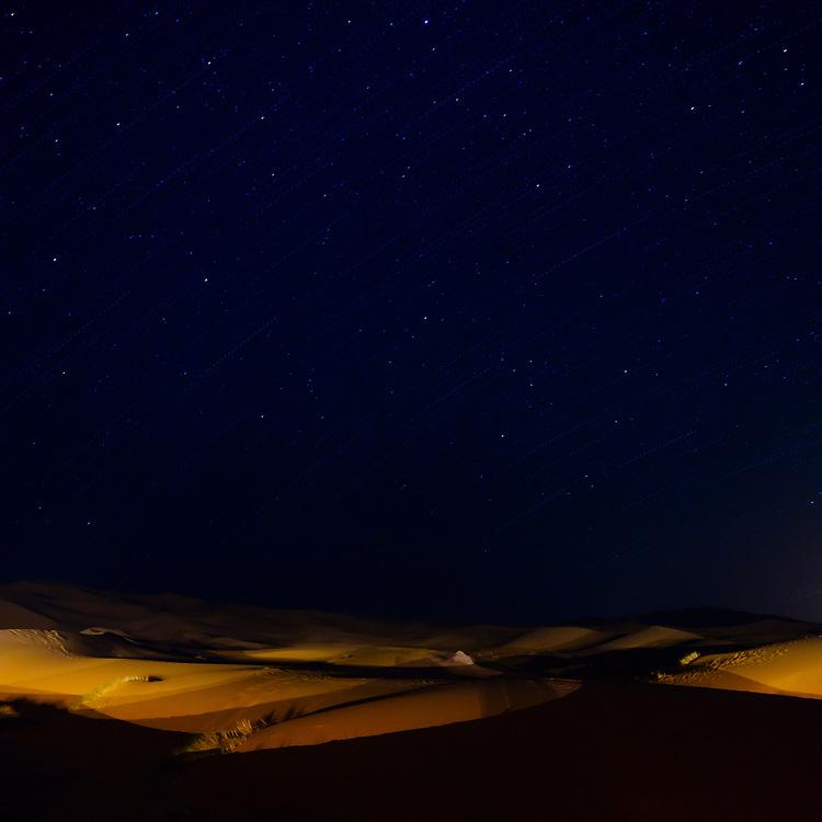MEKNES - TAFILALET, MOROCCO - CIRCA APRIL 2017: Night and stars over the dunes of the Sahara Desert