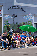03 JULY 2021 - NORWALK, IOWA: People wait for the 4th of July parade to start in Norwalk, Iowa. Last year's parade was cancelled because of the COVID-19 pandemic. Norwalk is an agricultural community south of Des Moines. In recent years, Norwalk has become a suburb of Des Moines.        PHOTO BY JACK KURTZ