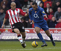 Photo: Alan Crowhurst. <br /> Southampton v Arsenal, 26/02/2005, Barclays Premiership. Arsenal's Thierry Henry takes on Nigel Quashie.