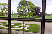 Green fields and trees are standing in front of Beningbrough Hall, Yorkshire, England, United Kingdom.