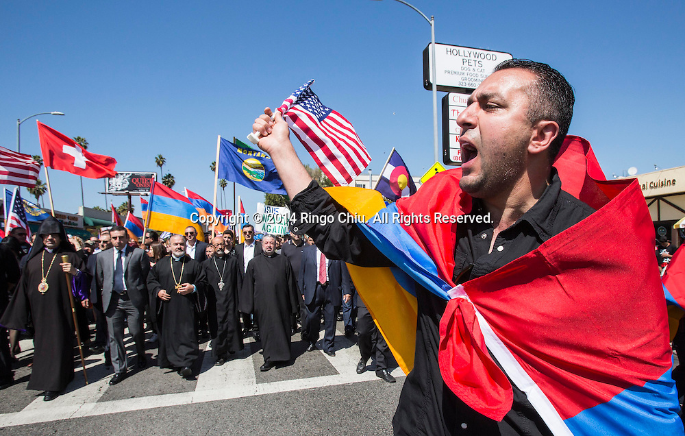 Meseop Agajanyan shouts slogans as thousands of Armenians march along Hollywood Boulevard to mark the 99th anniversary of the beginning of the Armenian genocide and to call on the Turkish government to recognize the deaths of about 1.5 million people, in Los Angeles on Thursday, April 24, 2014. (Photo by Ringo Chiu/PHOTOFORMULA.com)