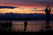 Sunset Hill Park lives up to its name as Seattleites watch the sun fade over the Olympic Mountains. (Ken Lambert / The Seattle Times)