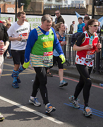 Virgin London Marathon 2013..Celebrity runners. Ed Balls looking knackered as he hits the wall at 21 miles, April 21, 2013. Photo by: Gavin Rodgers / i-Images