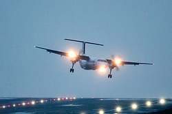 © Licensed to London News Pictures. 09/02/2019. Leeds UK. A Flybe aircraft landing at Leeds Bradford airport this morning as strong winds from Storm Erik continue to batter the UK. Photo credit: Andrew McCaren/LNP