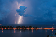 Nocturnal cloud-to-ground lightning on southern Biscayne Bay, Florida behind Miami's Rickenbacker causeway. WATERMARKS WILL NOT APPEAR ON PRINTS OR LICENSED IMAGES.