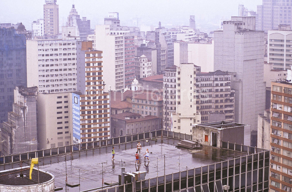 Knocking a football around on the rooftop of a skyscraper in downtown Sao Paulo, Brazil.