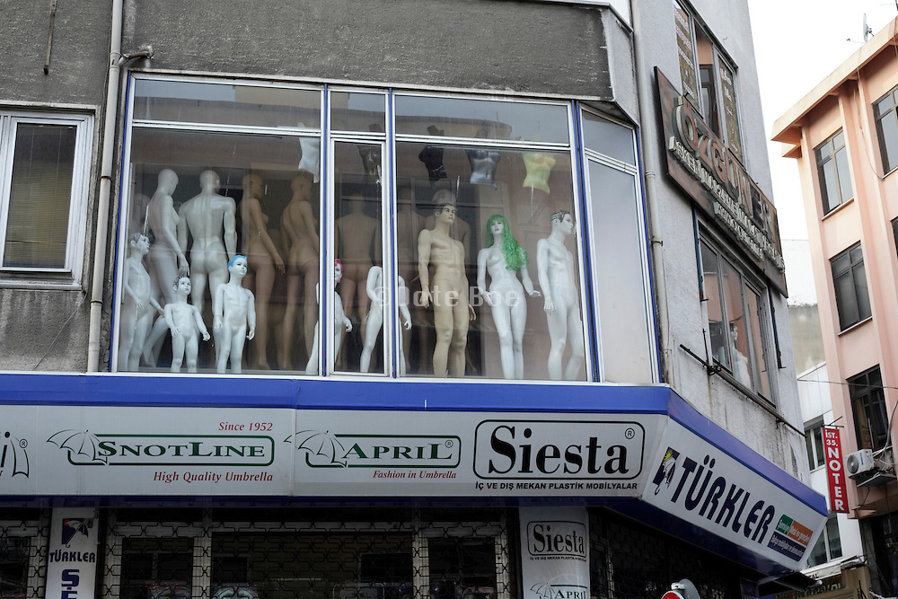 in window displayed mannequins wearing nothing