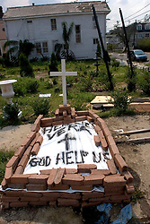 05 Sept  2005. New Orleans, Louisiana. Post hurricane Katrina.<br /> 'Here lies Vera - God help us.' The temporary grave of a resident of Uptown New Orleans lies at the crossroads of Magazine Street and Jackson Street in the ghost town that once was New Orleans.<br /> Photo; ©Charlie Varley/varleypix.com