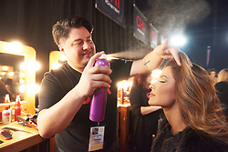 December 8, 2019, Atlanta, Georgia, USA: Gabriela Tafur Nader, Miss Colombia 2019 gets hair done by a stylist from Farouk Systems, the Makers of CHI & Biosilk backstage during The Miss Universe Competition telecast, held at Tyler Perry Studios. Contestants from around the globe have spent the last few weeks touring, filming, rehearsing and preparing to compete for the Miss Universe crown. (Credit Image: © Benjamin Askinas/Miss Universe Organization via ZUMA Wire)