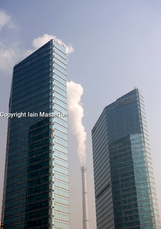 Smoking chimney of power station in close proximity to new high rise office buildings in central Beijing 2009