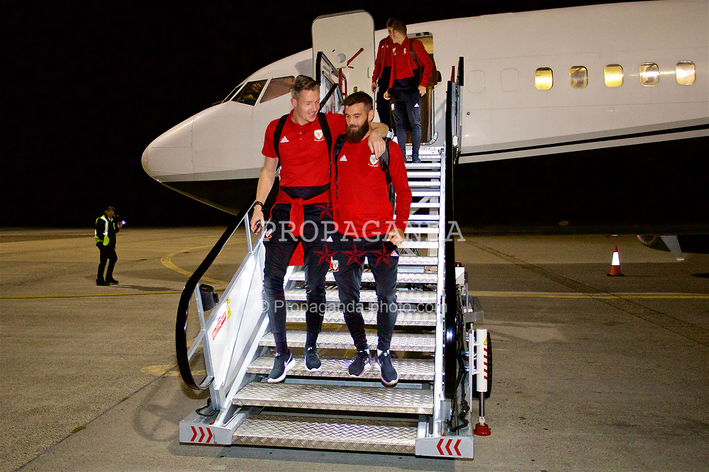 AARHUS, DENMARK - Saturday, September 8, 2018: Wales' goalkeeper Wayne Hennessey and Joe Ledley arrive at Aarhus airport ahead of the UEFA Nations League Group Stage League B Group 4 match between Denmark and Wales. (Pic by David Rawcliffe/Propaganda)
