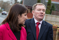 © Licensed to London News Pictures . 04/02/2014 . Sale , UK . Rachel Reeves and Chris Bryant . Rachel Reeves , MP for Leeds West and Shadow Secretary of State for Work and Pensions and Chris Bryant , MP for Rhondda and Shadow Minister for Welfare Reform , join Labour candidate Mike Kane on the campaign trail ahead of the Wythenshawe and Sale East by-election , following the death of MP Paul Goggins . They visit the home of Tony Gunning (51) who suffers from hereditary adult polycystic kidney disease and is on dialysis , who says he is affected by the bedroom tax . Photo credit : Joel Goodman/LNP