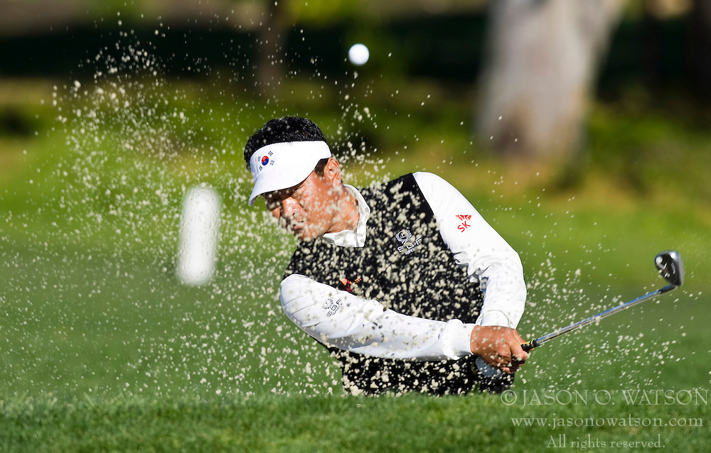 February 14, 2010; Pebble Beach, CA, USA;  K.J. Choi hits a bunker shot on the second hole during the final round of the AT&T Pebble Beach Pro-Am at Pebble Beach Golf Links.