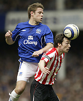 Photo: Aidan Ellis.<br /> Everton v Sunderland. The Barclays Premiership. 01/04/<br /> 2006.<br /> Sunderland's gary Breen heads the ball whilst under pressure from Everton's James Beattie