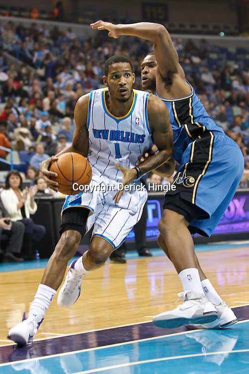 February 1, 2011; New Orleans, LA, USA; New Orleans Hornets small forward Trevor Ariza (1) drives past Washington Wizards center Trevor Booker (35) during the first quarter at the New Orleans Arena.   Mandatory Credit: Derick E. Hingle