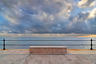 An impressive display of ominous clouds bathed in some beautiful warm light at the beach of Varigotti in Liguria, Italy. Due to the cold and windy conditions, I was the only spectator attending.