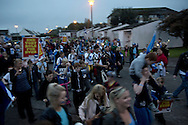 People walking through the streets during a spontaneous march to mobilise support for a pro-independence vote in the Craigmillar district of Edinburgh on the day of the independence referendum. Yes Scotland were campaigning for the country to leave the United Kingdom, whilst Better Together were campaigning for Scotland to remain in the UK. On the 18th of September 2014, the people of Scotland voted in a referendum to decide whether the country's union with England should continue or Scotland should become an independent nation once again and leave the United Kingdom.