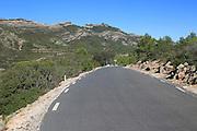 Road through mountain landscape near Xalo or Jalon, Marina Alta, Alicante province, Spain