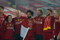 LIVERPOOL, ENGLAND - Wednesday, July 22, 2020: Liverpool's player liaison officer Ray Haughan, Mohamed Salah, head of fitness and conditioning Andreas Kornmayer, and Adam Lallana celebrate after being crowned Premier League champions after the FA Premier League match between Liverpool FC and Chelsea FC at Anfield. The game was played behind closed doors due to the UK government's social distancing laws during the Coronavirus COVID-19 Pandemic. Liverpool won 5-3. (Pic by David Rawcliffe/Propaganda)