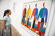 Tate Modern's new exhibition, of the avant-garde work of Russian Kazimir Malevich. Here Sportsmen. Tate Modern, Bankside, London, UK.