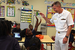 FORT LAUDERDALE, Fla. (May 4, 2017) Master Chief Musician Todd Smeltzer high-fives a student at the North Broward Academy of Excellence during a community relations event held during the 27th annual Fleet Week Port Everglades. Fleet Week Port Everglades provides an opportunity for the citizens of South Florida to witness first-hand the latest capabilities of today's maritime services, and gain a better understanding of how the sea services support the national defense of the United States. (U.S. Navy photo by Mass Communication Specialist 1st Class Ernest R. Scott/Released)170504-N-ZN152-0031 <br />