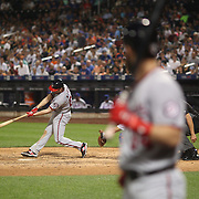 NEW YORK, NEW YORK - July 07: Daniel Murphy #20 of the Washington Nationals batting as Bryce Harper #34 of the Washington Nationals waits on deck during the Washington Nationals Vs New York Mets regular season MLB game at Citi Field on July 05, 2016 in New York City. (Photo by Tim Clayton/Corbis via Getty Images)