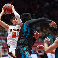 """Gallup Bengals Quinn Atazhoon (24) drives to the lane with a Del Norte Knights defender in the paint during the NMAA State Tournament. The Knights defeated the Bengals 55-49 at """"The Pit"""" in Albuquerque Wednesday evening."""