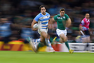 a pan blur image as Juan Imhoff of Argentina runs in to score his late 2nd half try.  Rugby World Cup 2015 quarter-final match, Ireland v Argentina at the Millennium Stadium in Cardiff, South Wales  on Sunday 18th October 2015.<br /> pic by  Andrew Orchard, Andrew Orchard sports photography.
