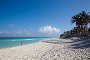 Two 2 people on Varadero beach in Matanzas province, Cuba's most popular beach resort welcoming thousands of guests every year from all over the world.