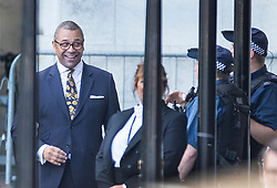 © Licensed to London News Pictures. 24/07/2019. London, UK. Conservative Party Deputy Chairman James Cleverly shares a joke with police officers in Parliament. The Conservative Party has elected Boris Johnson as their new leader and Prime Minister, following Theresa May's announcement that she will step down. Photo credit: Ben Cawthra/LNP