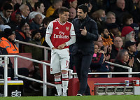 Football - 2019 / 2020 Premier League - Arsenal vs. Everton<br /> <br /> Mikel Arteta, Manager of Arsenal FC, gives instruction to Lucas Torreira (Arsenal FC) before he comes on at The Emirates Stadium.<br /> <br /> COLORSPORT/DANIEL BEARHAM