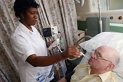 Rehabilitation Support Nurse checking Orthopaedic patients temperature and blood pressure,