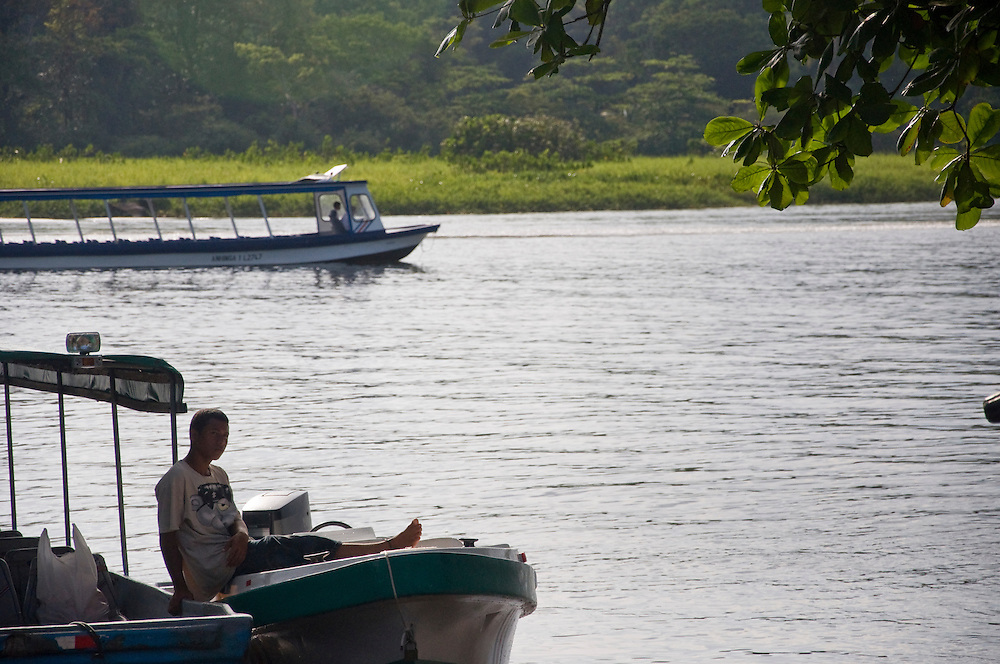 A boy waits on a boat in the public dock in Tortuguero, Costa Rica on April 8, 2009.  (Photo/Billy Byrne Drumm)