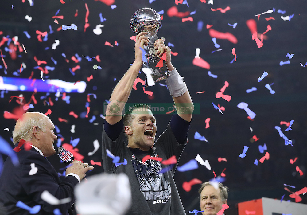 Tom Brady hoists the Lombardi Trophy, winning his fifth Super Bowl title, as the New England Patriots beat the Atlanta Falcons 34-28 in Super Bowl LI on Sunday, February 5, 2017 at NRG Stadium in Houston, TX, USA. Photo by Curtis Compton/Atlanta Journal-Constitution/TNS/ABACAPRESS.COM
