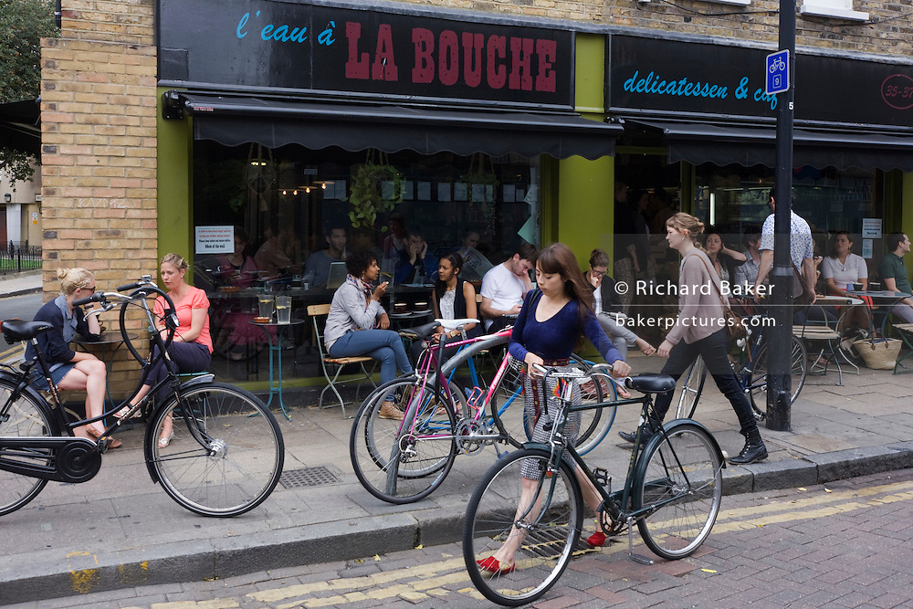 Cafe society in the popular Broadway Market, a gentrified area of the otherwise poor borough of Hackney and Haggerston.