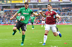 Lincoln City's Luke Waterfall (left) and Burnley's Sam Vokes battle for the ball