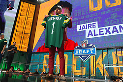 April 26, 2018 - Arlington, TX, U.S. - ARLINGTON, TX - APRIL 26:  Jaire Alexander holds up a jersey after being chosen by the Green Bay Packers with the 18th pick during the first round at the 2018 NFL Draft at AT&T Statium on April 26, 2018 at AT&T Stadium in Arlington Texas.  (Photo by Rich Graessle/Icon Sportswire) (Credit Image: © Rich Graessle/Icon SMI via ZUMA Press)