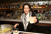 New York, NY - March 30, 2015: A bartender serving punch at Staff Meal, a fundraiser for Heritage Radio Network, at All'onda, near Union Square. <br /> <br /> CREDIT: Clay Williams for Heritage Radio Network.<br /> <br /> © Clay Williams / claywilliamsphoto.com