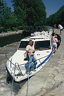 Going through a lock by renting a barge and traveling the Midi Canal in France.<br />Photo by Dennis Brack
