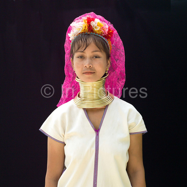 Ma Su 20 an ethnic Kayan woman from Myanmar at Baan Tong Luang, Eco-Agricultural Hill Tribes Village on 7th June 2016 in Chiang Mai province, Thailand. The fabricated village is home to 8 different hill tribes who make a living from selling their handicrafts and having their photos taken by tourists