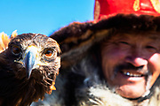 A master eagle hunter in Mongolia with his golden eagle in the Altai mountains, Bayan Olgii, Mongolia