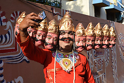 April 13, 2017 - Kolkata, India - An Indian man dressed as Raban takes a selfie as he participates in the Hindu festival known as Gajan. The Gajan festival falls on the last day of the Bengali calendar which also coincides with the birth of Lord Shiva, according to Hindu mythology. (Credit Image: © Debajyoti Chakraborty/NurPhoto via ZUMA Press)