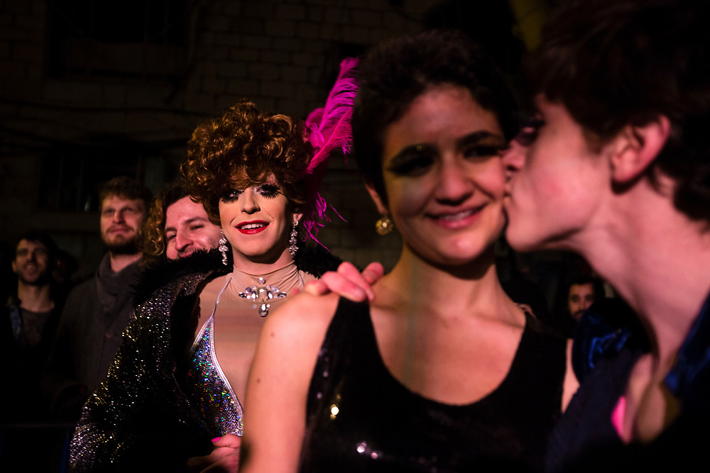 Israeli drag queens and transgenders are seen following a 'Drag Race' organized by The Jerusalem LGBT (lesbian, gay bisexual and transgender) community, in which competitors raced down a 50 meter stretch, wearing high heels, in central Jerusalem, Israel, on February 16, 2015. The event is part of the city's annual 'Winter Noise Festival' also dubbed 'Sound of Winter Festival' which features street performances, open bars and street art exhibitions.