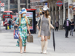 Licensed to London News Pictures. 12/07/2021. London, UK. (Left) Meve Gurkan 33 and Tugce Nur-Albulak, wear masks while on their way to visit Buckingham Palace Gardens in Victoria, London. Today, Prime Minister Boris Johnson will hold a TV press conference on the government's decision to go ahead with unlocking England from Covid-19 restrictions on 19 July 2021 with the possible dropping of rules on face masks, gatherings, social distancing and work from home rules. Photo credit: Alex Lentati/LNP