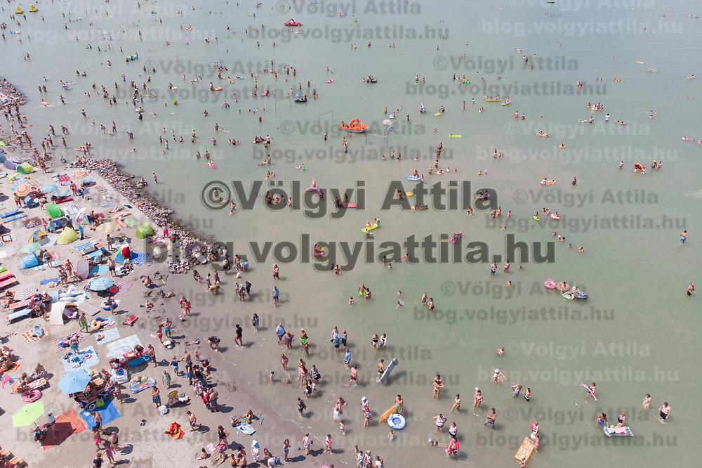 People take a summer bath in lake Balaton at Balatonlelle (about 140 km South-West of capital city Budapest), Hungary on July 14, 2018. ATTILA VOLGYI