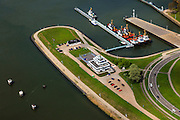 Nederland, Zeeland, Terneuzen, 09-05-2013; Sluizencomplex Terneuzen. Sleepboten bij de monding van het kanaal, kantoor Korps landelijke politiediensten (KLPD)<br /> View on the sluices of Terneuzen. Tugs at the mouth of the channel, National Police Agency (KLPD) office.<br /> luchtfoto (toeslag op standard tarieven)<br /> aerial photo (additional fee required)<br /> copyright foto/photo Siebe Swart