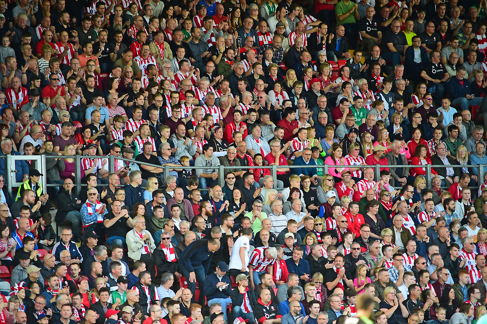 Lincoln City fans watch their team in action<br /> <br /> Photographer Andrew Vaughan/CameraSport<br /> <br /> The EFL Sky Bet League Two - Lincoln City v Cambridge United - Saturday 14th October 2017 - Sincil Bank - Lincoln<br /> <br /> World Copyright © 2017 CameraSport. All rights reserved. 43 Linden Ave. Countesthorpe. Leicester. England. LE8 5PG - Tel: +44 (0) 116 277 4147 - admin@camerasport.com - www.camerasport.com