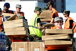 Volunteers carry boxes of tarps to hurricane victims Tuesday, September 18, 2018 in Wilmington, N.C. New Hanover County, in partnership with FEMA, the Civil Air Patrol and volunteers from General Electric, gave out free water, tarps and the Meals Ready to Eat to county residents at three locations in Wilmington. Photo by Chuck Liddy/Raleigh News & Observer/TNS/ABACAPRESS.COM