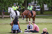 British mounted police officers secure the area as people, most wearing protective masks against the spread of coronavirus, wait for a protest organised by Black Lives Matter, in Hyde Park, London, Saturday, June 20, 2020, in the wake of the killing of George Floyd by police officers in Minneapolis, USA last month that has led to anti-racism protests in many countries calling for an end to racial injustice. Anti-racism demonstrators are holding a fourth weekend of protests across the U.K., despite a ban on large gatherings because of the coronavirus pandemic. Demonstrations are taking place Saturday in cities including London, Manchester, Edinburgh and Glasgow. (Photo/ Vudi Xhymshiti)